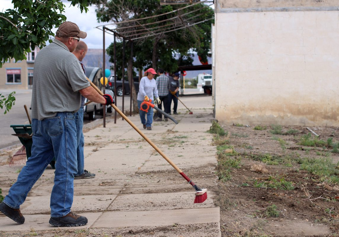 """The mayor and other members of the community at a """"Brooms of Broadway cleanup"""