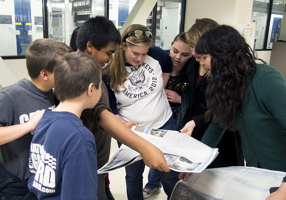 GRHS students seeing the first Green River Newspaper hot off the press