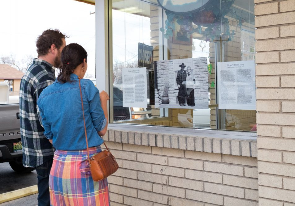 Local residents read one of the narratives hanging at Chow Hound